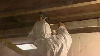 Worker clearing asbestos