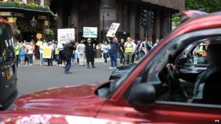 Drivers with placards protesting