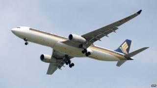This photograph taken on 4 May 2014 shows a Singapore Airlines (SIA) aircraft approaching Changi International Airport in Singapore
