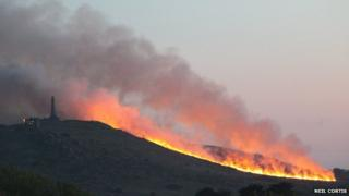 A large area of gorse on fire at Carn Brea