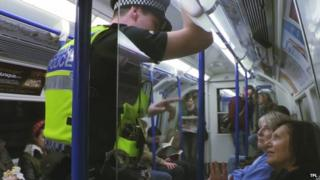 Police officer on the Tube