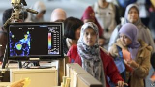 A thermal camera monitor shows the body temperature of passengers arriving from overseas against possible MERS, Middle East Respiratory Syndrome, virus at the Incheon International Airport in South Korea Thursday, 21 May 2015.