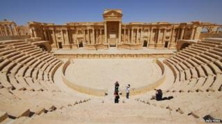 Tourists take pictures at the ancient Palmyra theatre in the historical city of Palmyra on 18 April 2008.