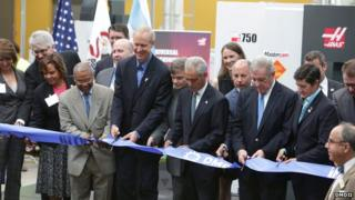 Men opening the Digital Manufacturing and Design Innovation Institute