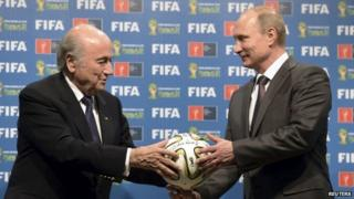 """Russia""""s President Vladimir Putin (R) and FIFA President Sepp Blatter take part in the official handover ceremony for the 2018 World Cup scheduled to take place in Russia, in this file picture taken in Rio de Janeiro, Brazil, July 13, 2014."""
