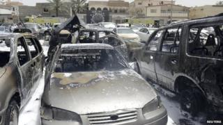 Damaged cars are seen after a car exploded near a Shia mosque in Saudi Arabia's Dammam 29 May 2015.