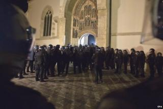 Over 100 Croatian war veterans have taken refuge inside a church after police disrupted their anti-government protest in central Zagreb.