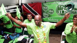 Jack Warner waving