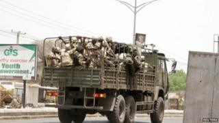 Soldiers are seen on a truck along a road in Maiduguri in Borno State, Nigeria 14 May 2015