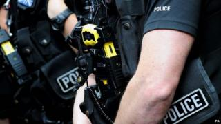 British police officer armed with a Taser