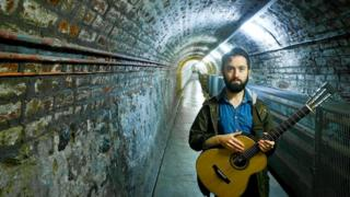 Villagers' Conor O'Brien in the tunnel at Crumlin Road Gaol.