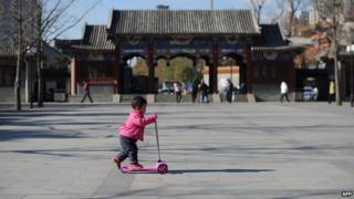 A child plays on a scooter in China