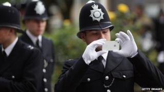 Police officer using camera phone