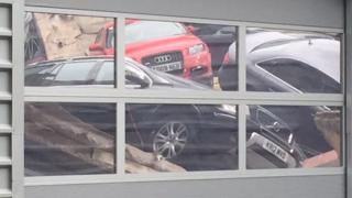 Cars piled up at the Audi showroom in Milton Keynes