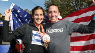 Kara and Adam Goucher with her medal after her third place finish at the New York marathon in 2008