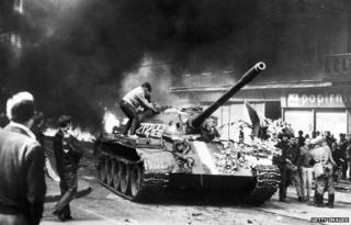 Prague resident climbs on Soviet tank in Prague in 21 August 1968