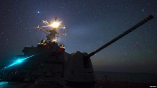 The Pentagon says the USS Ross is travelling international waters
