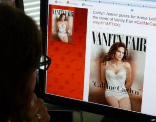 A journalist looks at Vanity Fair's Twitter site with the Tweet about Caitlyn Jenner, who will be featured on the July cover of the magazine.
