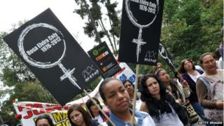 People march at Bogota's National Park on 3 June 3, 2012 to reject the brutal torture, rape and murder of 35-year-old Rosa Elvira Cely