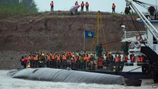 Rescue workers are seen next to the capsized passenger Eastern Star in the Yangtze River in China - 3 June 2015