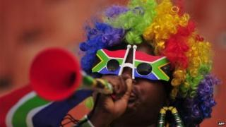 South Africa supporter blows a vuvuzela prior to the start of the Group F first round 2010 World Cup football match Paraguay vs. New Zealand on June 24, 2010 at Peter Mokaba stadium in Polokwane
