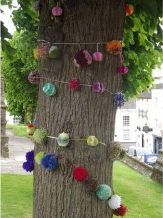 St John's Church tree covered in pom poms