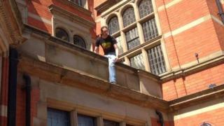 Protester climbing onto the roof of the East Riding Council offices