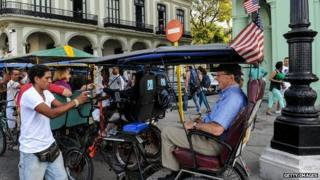 Cycle taxi with US flag in Havana. 30 Jan 2015