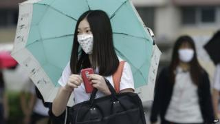 South Korean student wears mask as she goes to school in Seoul on 5 June 2015