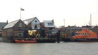 Woman being treated at a lifeboat station