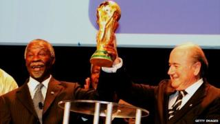 Thabo Mbeki (left) lifts the World Cup aloft with former Fifa President Sepp Blatter in Berlin, Germany - 7 July 2006
