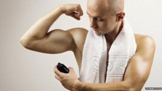 Man using deodorant spray