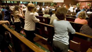 Parishioners kneel during a prayer service at St. Olaf Catholic Church on 2 August 2007 in Minneapolis, Minnesota.