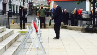 Mitchel McLaughlin lays a wreath during the commemoration