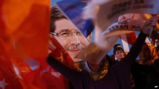 A poster of Turkey's Prime Minister and leader of the Justice and Development Party (AKP) Ahmet Davutoglu
