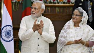Mr Modi (left) and Bangladesh Prime Minister Sheikh Hasina (right) signed important deals on Saturday