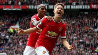 Ander Herrera of Manchester United celebrates with team-mate Ashley Young of Manchester United after scoring the opening goal during the Barclays Premier League match between Manchester United and Aston Villa at Old Trafford on April 4, 2015 in Manchester, England.