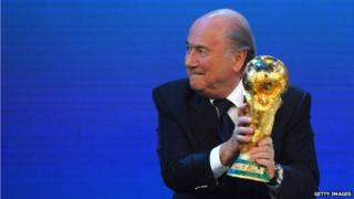 FIFA President Joseph S Blatter holds the world cup trophy, 2 December 2010