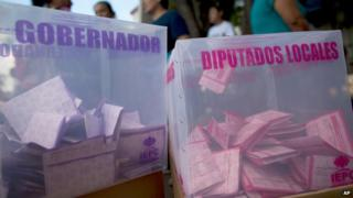 Ballot papers sit inside plastic voting boxes, at a polling station in Tixtla, Guerrero State, Mexico (7 June 2015)