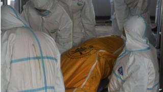 In this Saturday, 6 June 2015 photo released by China's Xinhua News Agency, rescuers carry the body of a victim in the hull of the upright ship Eastern Star in the section of Jianli on the Yangtze River, central China's Hubei Province.
