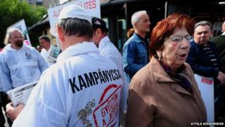 Activist and sympathizers of the far-right party Jobbik, in white, show up at a campaign event of the Hungarian left-wing opposition parties in Budapest