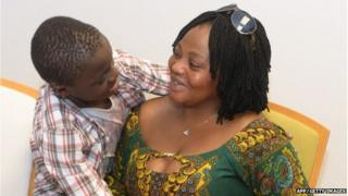 A handout pictured realeased and taken on June 8, 2015 shows Ivorian boy Adou Ouattara (L) hugging his mother Lucie Ouattara after being reunited with her in Ceuta.