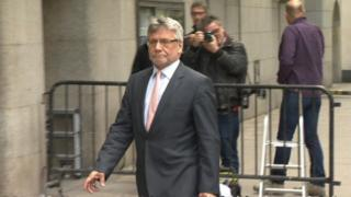 Former executive editor of the former British newspaper the News of the World, Neil Wallis, arrives at the Old Bailey in London on June 8, 2015