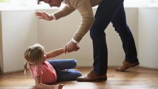 Father smacking his daughter