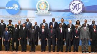 Egypt's President Abdel Fattah al-Sisi posing for a picture with officials and attendants of the African summit meeting in the Egyptian resort of Sharm el-Sheikh