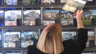 Woman at estate agent