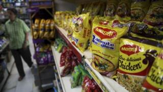 "Packaged food with ""Maggi"" sign on it are displayed at a grocery store in Bangalore, India, Friday, June 5, 2015"