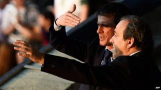 A picture taken on 6 June 2015 shows French Prime Minister Manuel Valls and UEFA President Michel Platini (R) talk prior to the UEFA Champions League Final football match between Juventus and FC Barcelona at the Olympic Stadium in Berlin