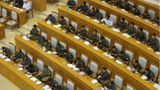 Military members of parliament attend the union parliament session in Naypyidaw on 9 April 2015