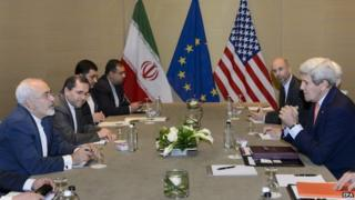 US Secretary of State John Kerry, (R), speaks with Iranian Foreign Minister Mohammad Javad Zarif, (L), before a bilateral meeting for a new round of Nuclear Iran Talks at the Intercontinental Hotel, in Geneva, Switzerland, 30 May 2015.